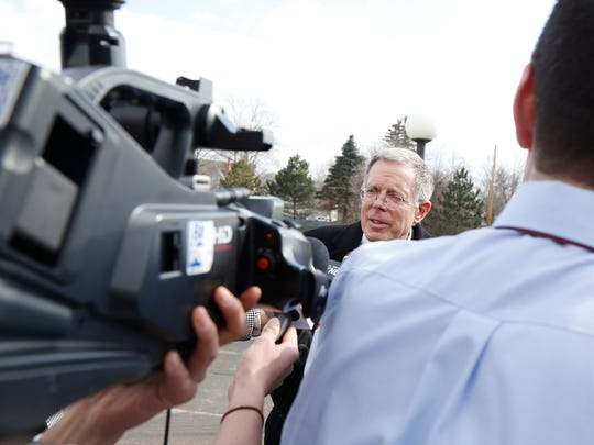 Thomas Clayton's attorney, Ray Schlather talks with the media after his client was found guilty on two murder charges Feb. 23.