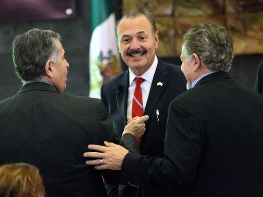 Marcos Bucio, center, consul general of Mexico in El