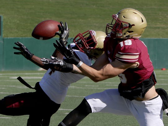 Midwestern State University's Robert Grays deflects