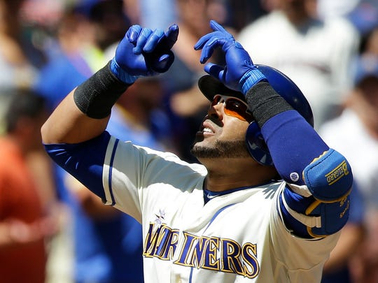 Seattle Mariners' Nelson Cruz looks up as he crosses the plate after he hit a three-run home run in the first inning of a baseball game against the New York Mets, Sunday, July 30, 2017, in Seattle. (AP Photo/Ted S. Warren)