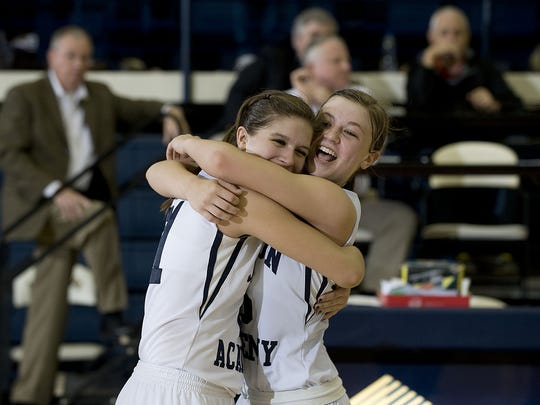Jackson Academy guards Mollie Blair (left) and Carly Chinn celebrate their win over undefeated Leake Academy during the semifinals of the Mississippi Association of Independent School's Overall tournament at Mississippi College in Clinton Friday afternoon. (Will Smith/special to The Clarion-Ledger)