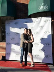 Ryan and Antoinette Kramar pose in front of Orin Jewelers on Main Street in downtown Northville during the red carpet grand reopening of the store opened by Antoinette's father, Orin J. Mazzoni Jr., in 1981.