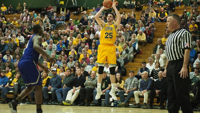 Catamounts forward Drew Urquhart (25) shoots a 3-pointer during the men's basketball game between Western Carolina and Vermont in the opening round of the College Basketball Invitational at Patrick Gym on Wednesday night.