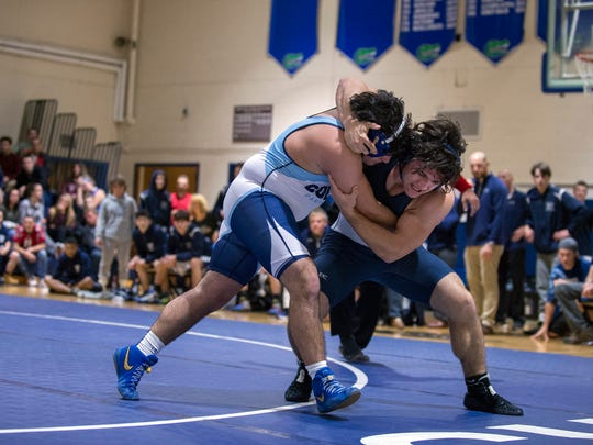 Collingswood's Billy Plianthos, left, wrestles Gateway's Kyle Albeser in a 195 pound match Friday, Dec. 22, 2017 in Woodbury Heights, New Jersey.