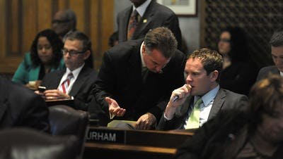House Majority Whip Jeremy Durham (seated) said Tuesday he thinks a school voucher bill will die in a House committee.