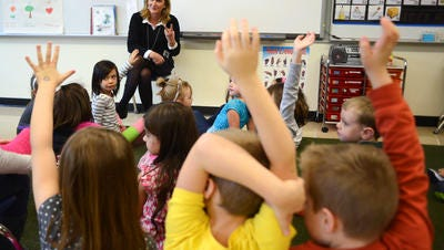 Kindergarten teacher Kathie Bridges asks her students to raise their hands to tell her stories about what happened over break at Battle Creek Elementary School on Monday, January 5, 2015, in Salem.
