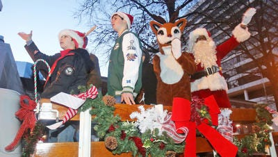 Santa and Rudolph greet visitors at the 2014 City Lights, Bright Holiday Night's celebration in White Plains.