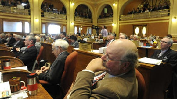 Legislators listen to the State of the State speech earlier this year.