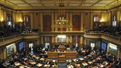 Facing a money crunch, Colorado lawmakers resorted to extraordinary feats to craft a $27 billion budget bill Thursday, eliminating a $59 million taxpayer refund, slashing $73 million in payments to hospitals and cutting $50 million for road construction.
