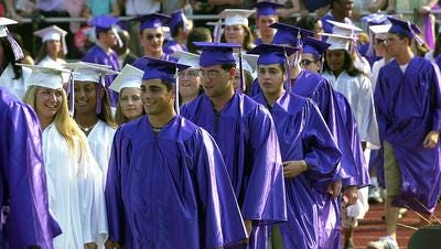 Traditional blue and white commencement garb at New Rochelle High School.