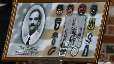 A memorial photo honoring New York City Fire Marshal Ronald Bucca.