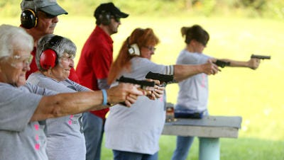 Women Armed and Ready members practice last week in Versailles, Indiana. Instructor Dale Reatherford watches as Barb Maness, 75, second from left, uses a Ruger.