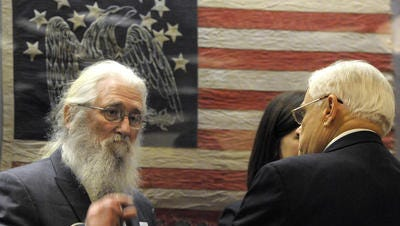 State Sen. Ken Yager, right, talks with Howard Switzer, head of the Green Party of Tennessee, at a January hearing on ballot access. (FILE PHOTO)