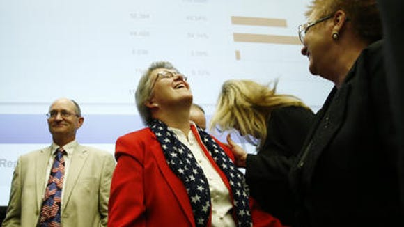 Successful schools superintendent candidate Diane Douglas laughs with supporters at all the opponents who could have voted against her, but apparently forgot about there being an election