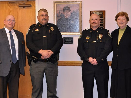 COTC's Pataskala campus honored Thomas W. Cottrell, a 2002 Basic Police Academy graduate, by hanging his portrait at the Pataskala campus. A ceremony was held on Feb. 20, and members of Cottrell's family attended the event, in addition to representatives from area law enforcement agencies. Pictured from left to right are COTC Institute for Public Services and Safety Director Kevin Reardon, Danville police Chief Daniel Weckesser, Pataskala police Chief Bruce Brooks and COTC President Bonnie L. Coe.