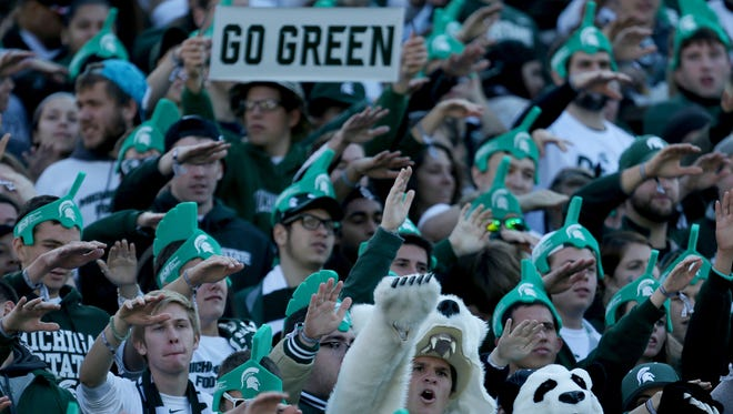 Michigan State fans cheer on their team before action against Michigan on Oct. 25, 2014, at Spartan Stadium in East Lansing.