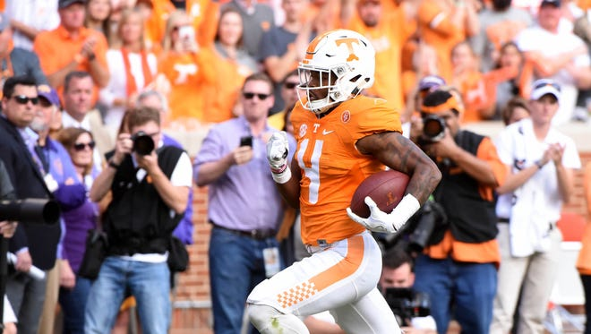 Tennessee running back John Kelly runs for a touchdown against Tennessee Tech during the first half at Neyland Stadium on Nov. 5, 2016.