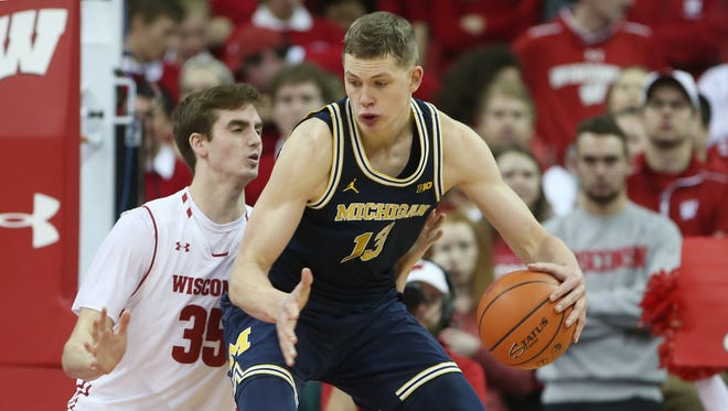 Moritz Wagner with the ball against Wisconsin's Nate Reuvers during Michigan's 83-72 win on Sunday in Madison, Wis.