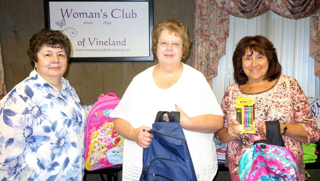 Woman's Club of Vineland members (from left) Patricia Amico, Rita Galasso and Linda Gallina sort through school supplies collected at a recent club meeting for donation to the Boys & Girls Club of Vineland.