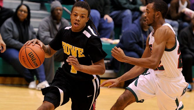 Howe's Harris Brown brings the ball up court against Tech during the semifinals of the city basketball tournament, Saturday, January 25, 2014, in Indianapolis.