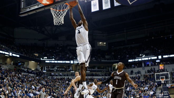 Xavier Musketeers guard Edmond Sumner (4) dunks during the first half against the Lehigh Mountain Hawks guard Kahron Ross (1) at the Cintas Center.