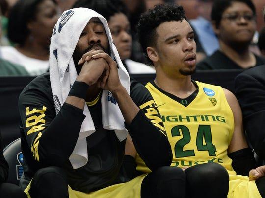 Oregon's Dillon Brooks sits with teammate Dwayne Benjamin