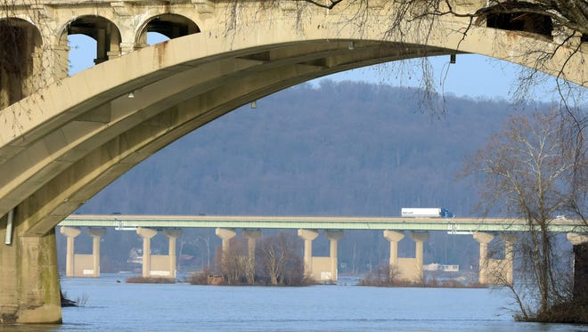 Friday, Jan. 15, 2016-Police say several people witnessed a Lancaster man stop his car in the travel lanes of the Route 30 bridge, background, and jump into the Susquehanna River at 7:10 p.m. Thursday.
