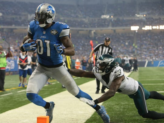 Detroit Lions Calvin Johnson catches a touchdown against