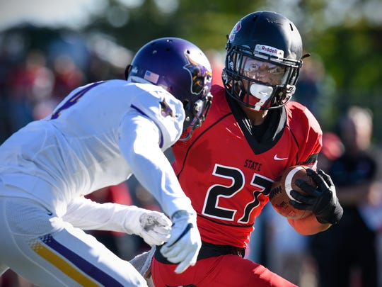 St. Cloud State's Jaden Huff carries the ball during the Saturday, Sept. 17, game at Husky Stadium in St. Cloud.