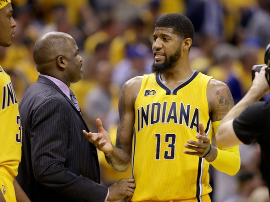 Indiana Pacers forward Paul George (13) talks to head coach Nate McMillan during a timeout in the second half  of their NBA playoff game Thursday, April 20, 2017, evening at Bankers Life Fieldhouse. The Cleveland Cavaliers defeated the Indiana Pacers 119-114.