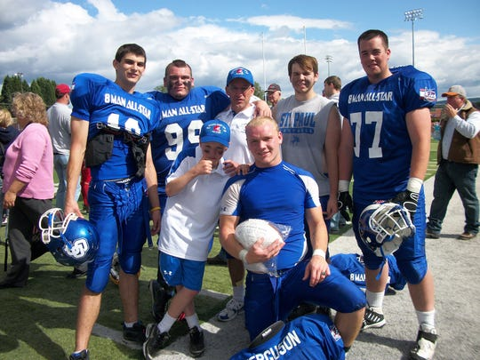 St. Paul head coach Tony Smith (back row center), son Holden (front left) with seniors from St. Paul's 2009 Class 1A state championship football team.