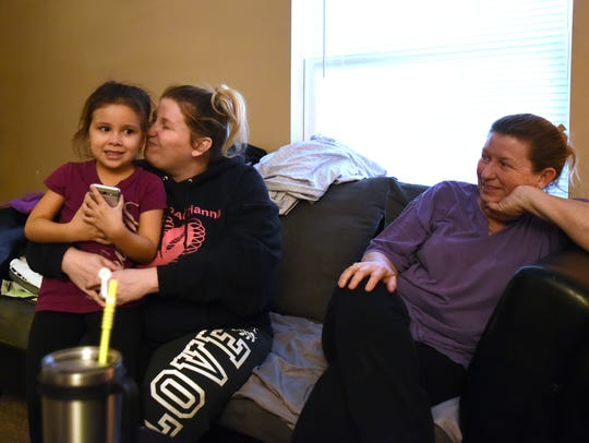 Alessa Gonzalez, 6, sits with her mother, Ashley McMullen,