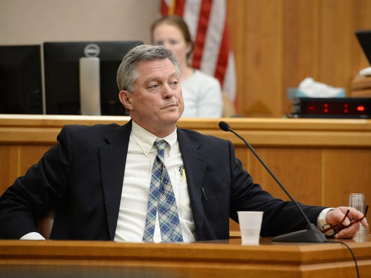 Eric Sutherland takes the witness stand in Judge Thomas French's courtroom at Larimer County Justice Center on Tuesday, January 10, 2016. Sutherland and PSD went to court for a trial over whether or not Sutherland was denied due process when his pre-election lawsuit was thrown out when he failed to pay a requested $8,000 surety bond.