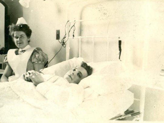 Violet Martin Reeves at the side of a patient.