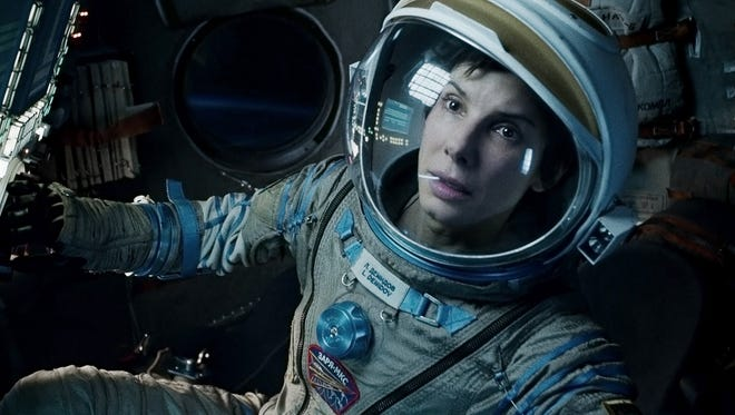 """Sandra Bullock in a scene from """"Gravity."""" The film was nominated for a Golden Globe for best motion picture drama on Thursday, Dec. 12, 2013.  The 71st annual Golden Globes will air on Sunday, Jan. 12."""