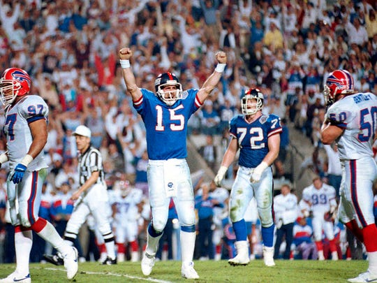 FILE - In this Jan. 27, 1991, file photo, New York Giants quarterback Jeff Hostetler celebrates a second-quarter touchdown against the Buffalo Bills during NFL football's Super Bowl XXV in Tampa, Fla. The Giants went 3-3 down the stretch and lost quarterback Phil Simms to a foot injury in Week 14, leaving the offense–such as it was–in the hands of a largely unproven Hostetler. (AP Photo/File)