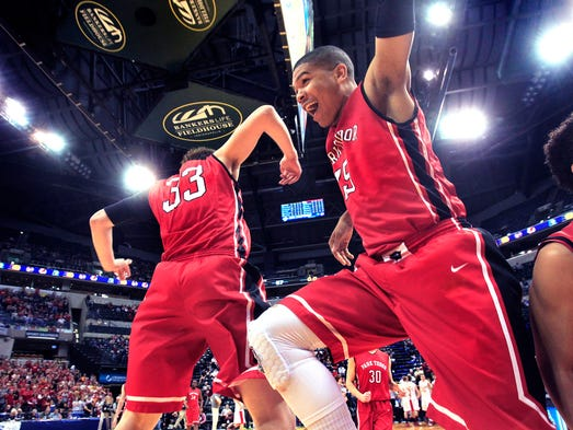 Park Tudor Panthers Dwayne Gibson Jr., right, and Nick Beeson celebrate as Park Tudor won the Class 2A basketball title with their 84-57 win over Westview at Bankers Life Fieldhouse.