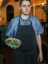 Justin Uchtman, executive chef at Sartre OTR, with