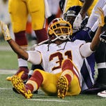 Aug 23, 2014; Baltimore, MD, USA; Washington Redskins safety Brandon Meriweather (31) reacts after being called for a personal foul against the Baltimore Ravens at M&T Bank Stadium. Mandatory Credit: Mitch Stringer-USA TODAY Sports