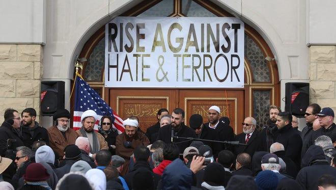 Ali Dabja, of Dearborn Heights addresses a crowd of people who came to the front of the Islamic Center of America in Dearborn, Michigan last December.
