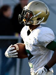 York Catholic's Jakkar Kinard runs in a touchdown during