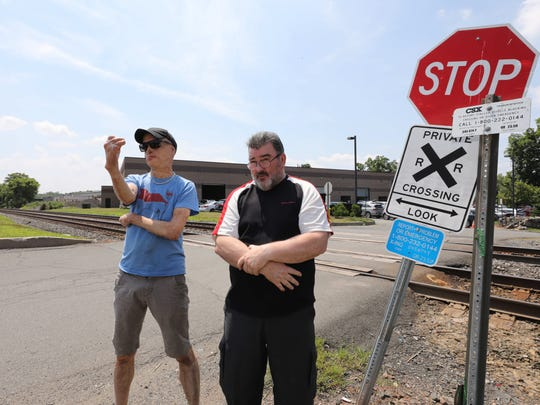 Ray LeVier and Bart Fitzsimons stand next to the private railroad crossing that lead to their neighborhood on Pineview Road in West Nyack, July 16, 2018.