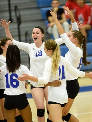 The Cedar Crest volleyball team celebrates a winning point in Monday night's win over Lebanon.