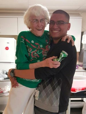 Muggs Johnson, LPN, and Lawrence Macias share a hug during break time at Mimbres Memorial Hospital and Nursing Home in Deming. Johnson served the community healthcare facility for 34 of its 60 years in existence.