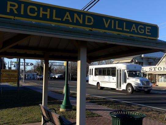 A free shuttle bus passes through Richland Village.