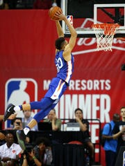 July 7: Knicks forward Kevin Knox throws down a monster two-handed slam against the Hawks.