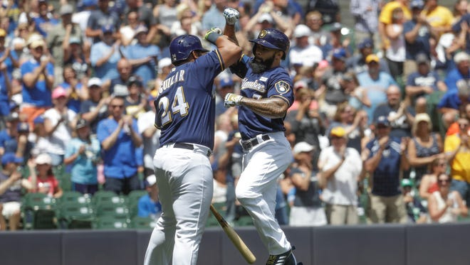 The Brewers' Eric Thames celebrates his home run during the first inning against the Dodgers on Sunday.