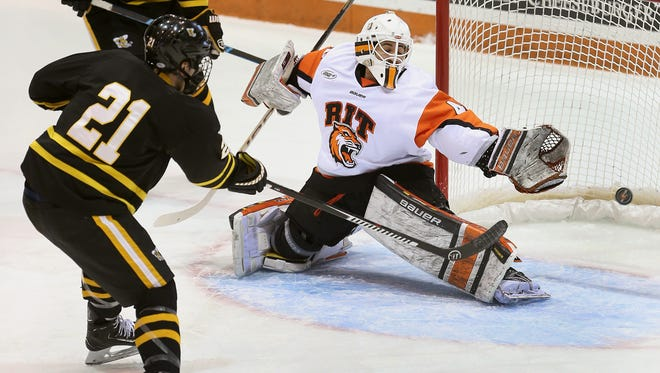 THE PHOTO: RIT goalie Nick Amato  can't reach this shot by AIC's Marc Dubeau for a first period goal. FROM JAMIE: This is just a nice action picture of a goal on a perfect pass.