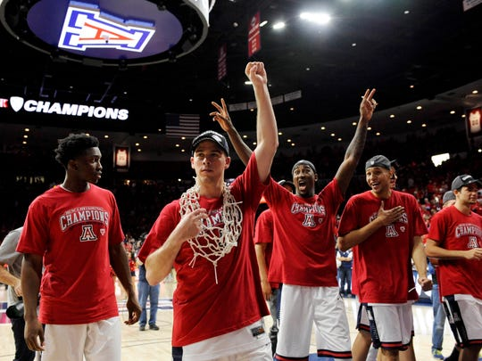 Mar 7, 2015: From left Arizona Wildcats forward Stanley Johnson (5) , guard T.J. McConnell (4) , forward Rondae Hollis-Jefferson (23) , forward Brandon Ashley (21) and guard Elliott Pitts (24) walk off of the court after beating the Stanford Cardinal at McKale Center. Arizona won 69-91.