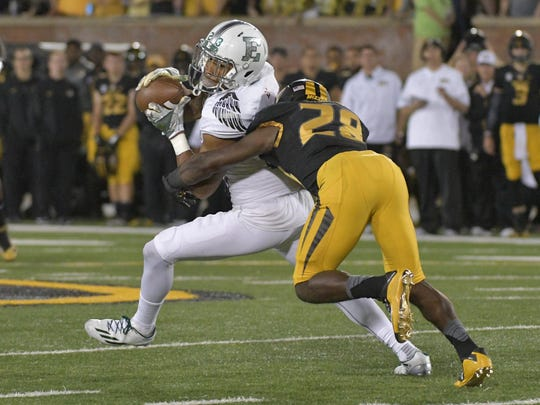 Eastern Michigan Eagles receiver Sergio Bailey II catches a pass against Missouri's Logan Cheadle at Faurot Field on Sept. 10, 2016 in Columbia, Mo. Missouri won, 61-21.
